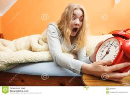 woman-waking-up-late-turning-off-alarm-clock-panic-morning-young-girl-laying-bed-56705841